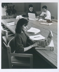 Students at Work with Early Laptops in a Group Study Room in the Mendik Library, circa 1990s