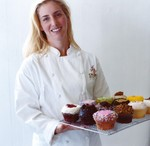 Mia Bauer, Class of 1996, founded Crumbs Bake Shop in 2003.